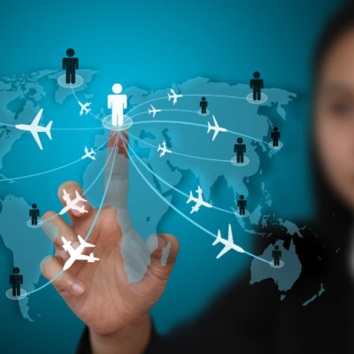 businesswoman touch on virtual screen for world business travel transport concept (selective focus on finger)